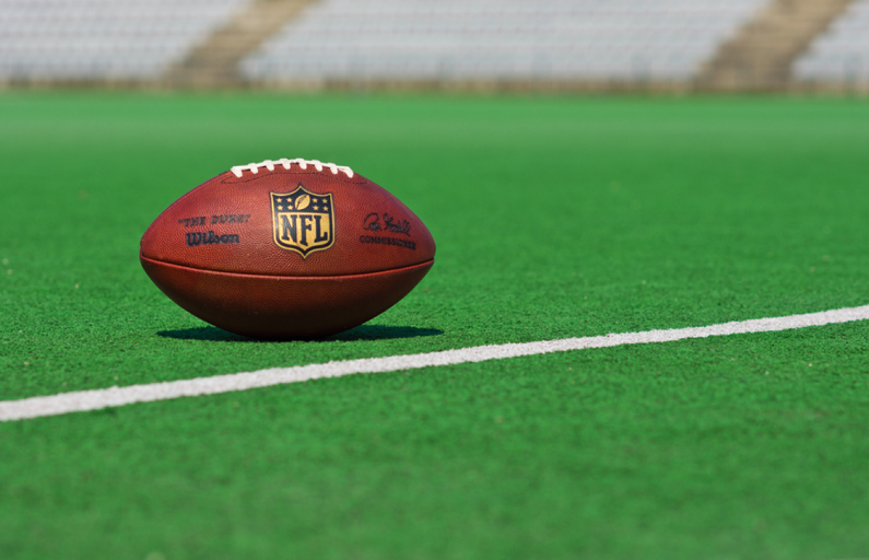 NFL-branded football on pitch