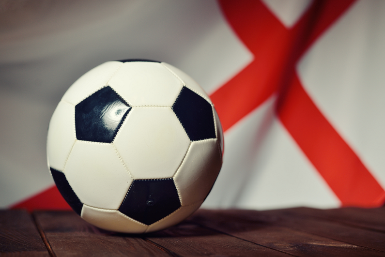 flag of England with soccer ball on wooden boards
