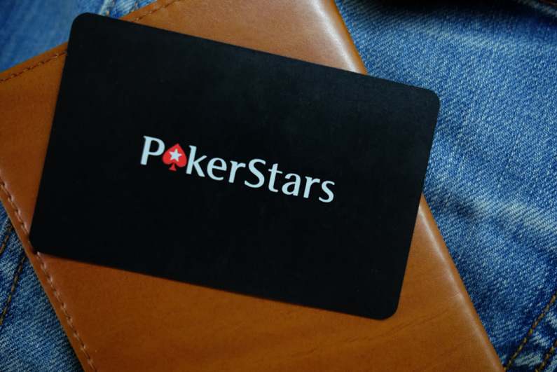 PokerStars logo against a leather case