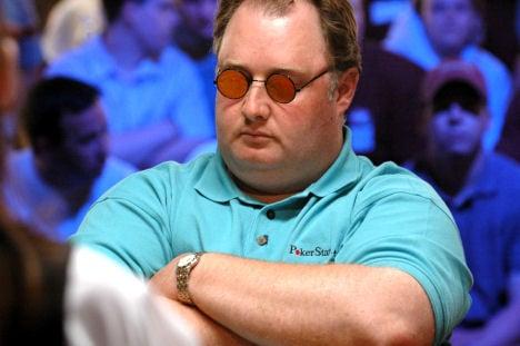 Poker pro Greg Fossilman Raymer wearing sunshades
