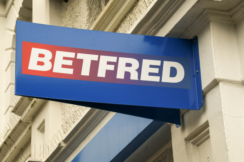 sign above the entrance to a Betfred betting shop