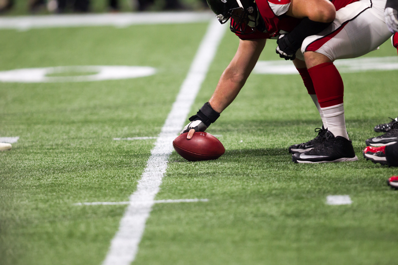 NFL player in position for play to begin