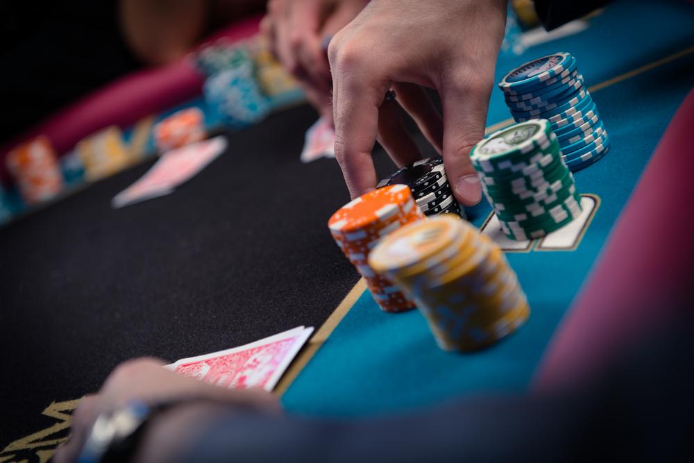 poker player manipulating chip stacks
