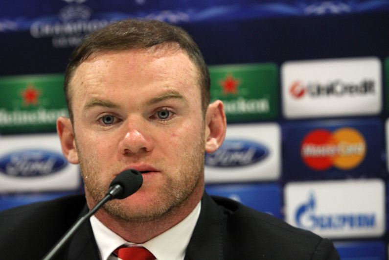 Wayne Rooney speaking at a press conference