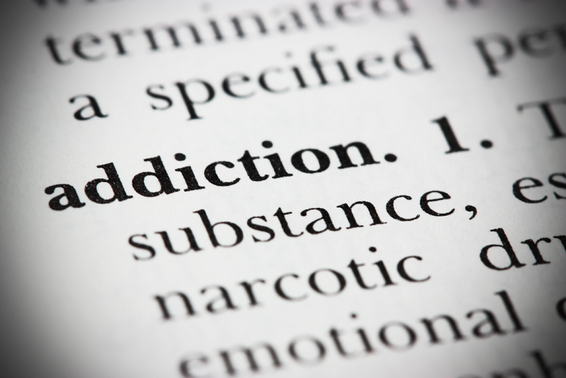 closeup of 'addiction' in dictionary