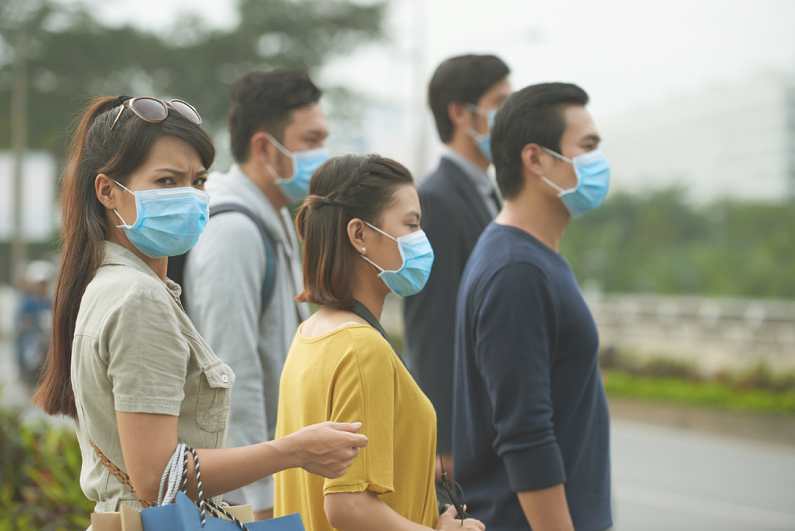 people wearing face masks because of virus outbreak
