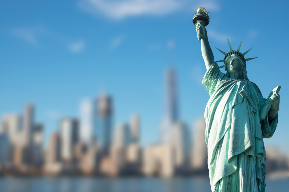 Statue of Liberty against blurred New York background