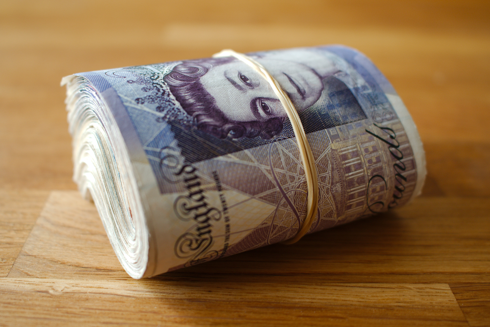 British pounds rolled up