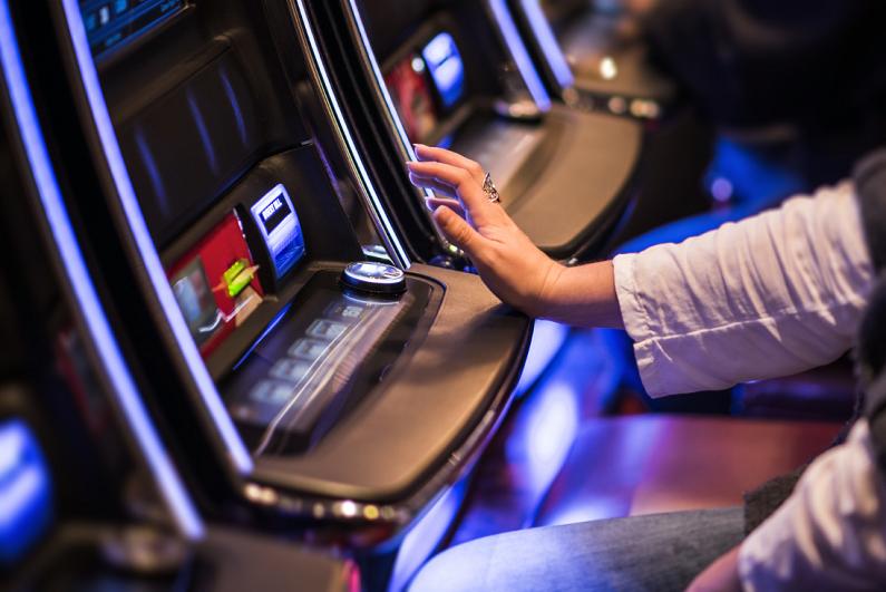 female using a gambling machine