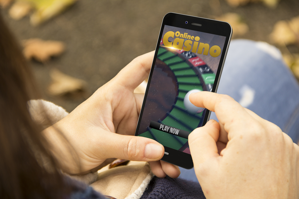 woman gambling at online casino on mobile