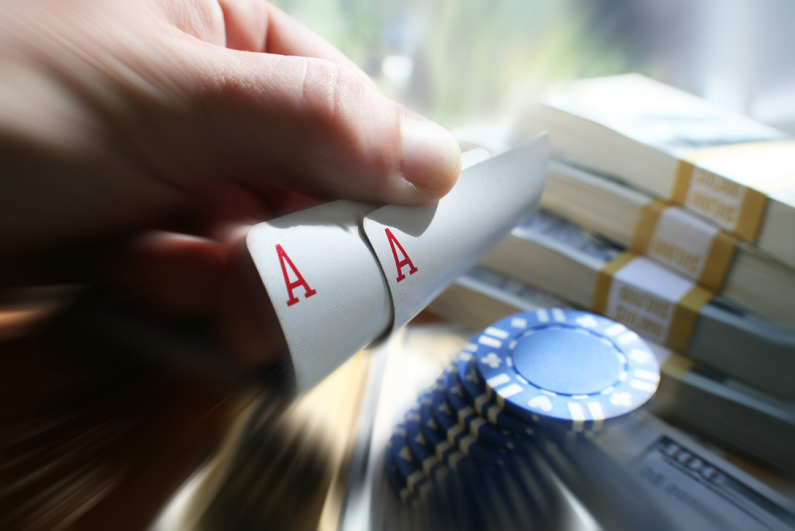 poker player holding pocket aces