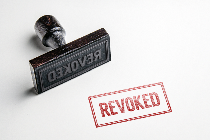 Rubber stamping that says 'Revoked'