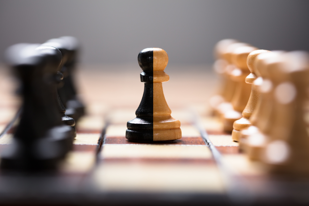 dual-colored chess piece on chess board