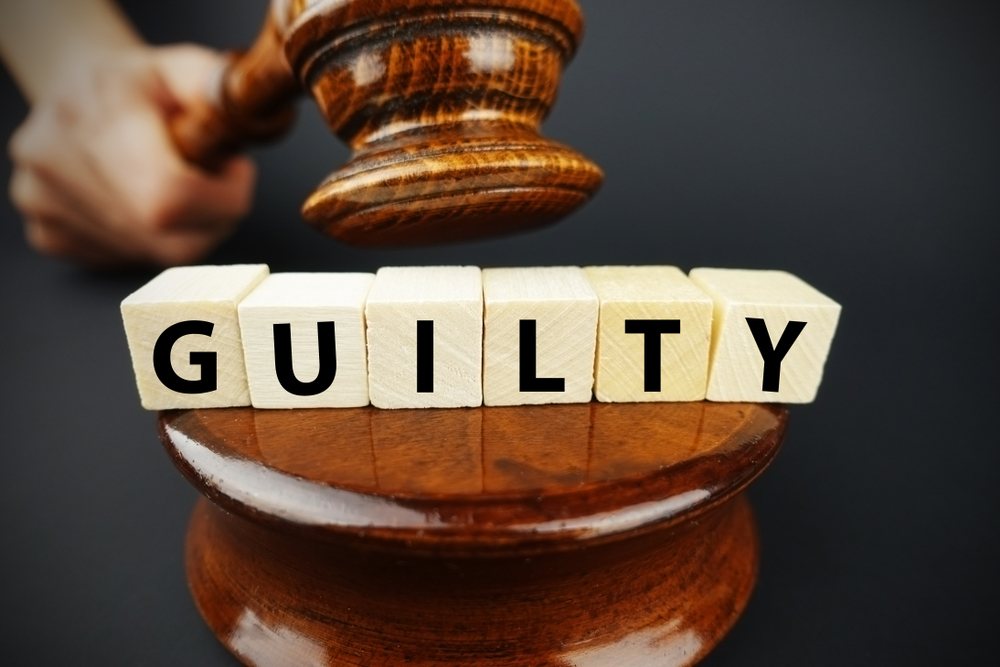 Guilty court decision with judge's gavel and wooden cubes that read GUILTY