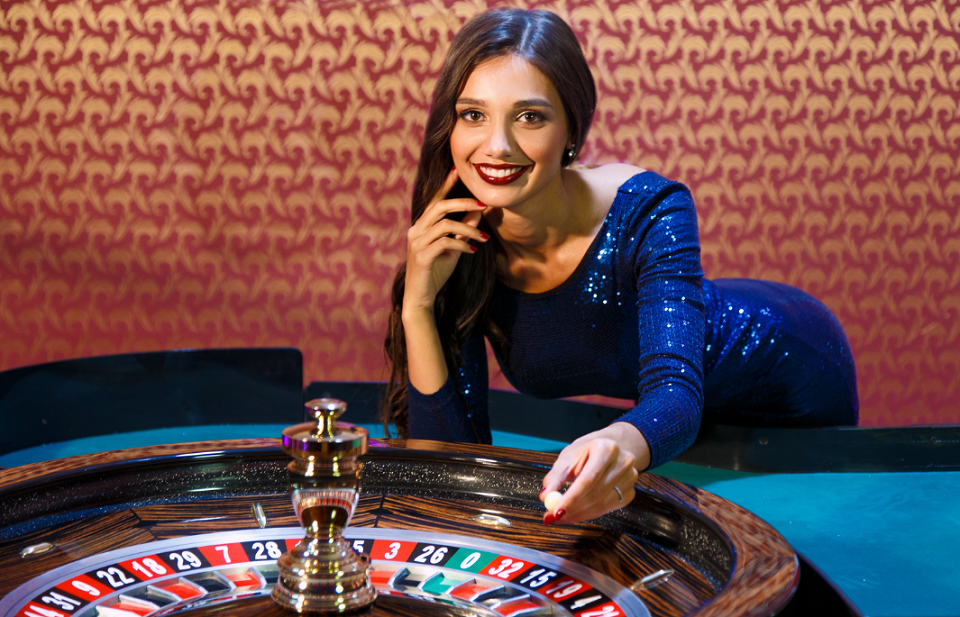 female host at roulette table