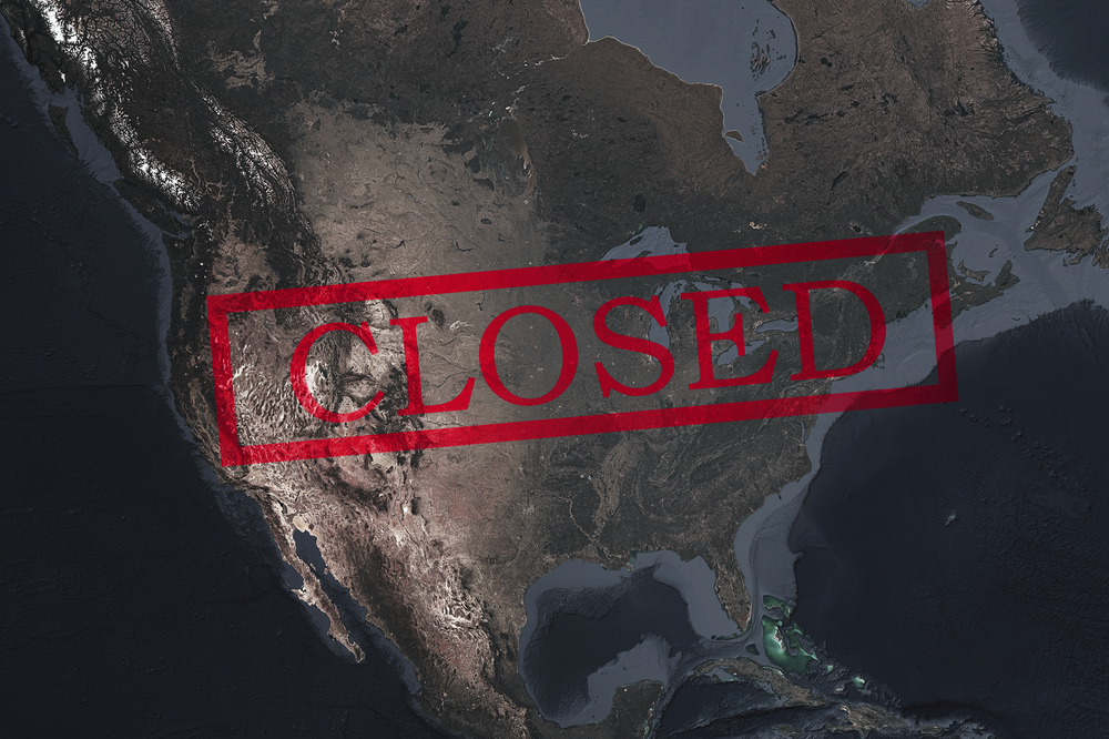closed sign over a satellite view of the US