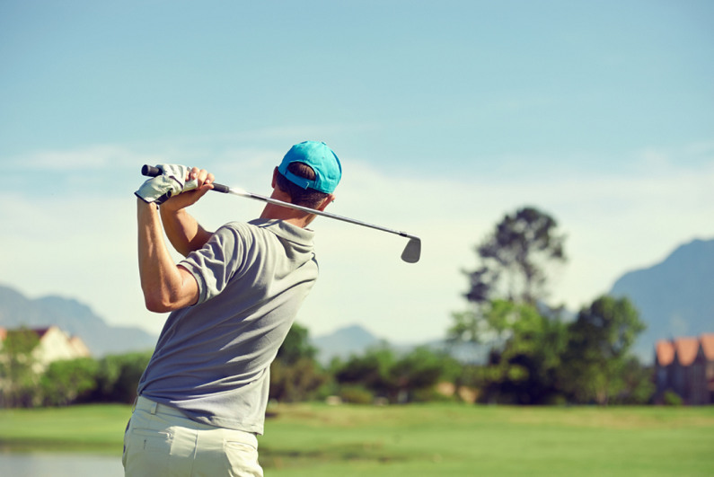 golfer hitting shot with a club