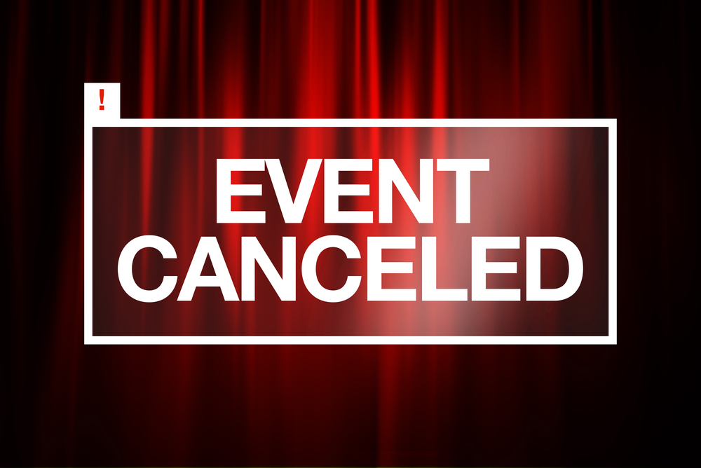 notice reading event canceled against a red curtain backdrop
