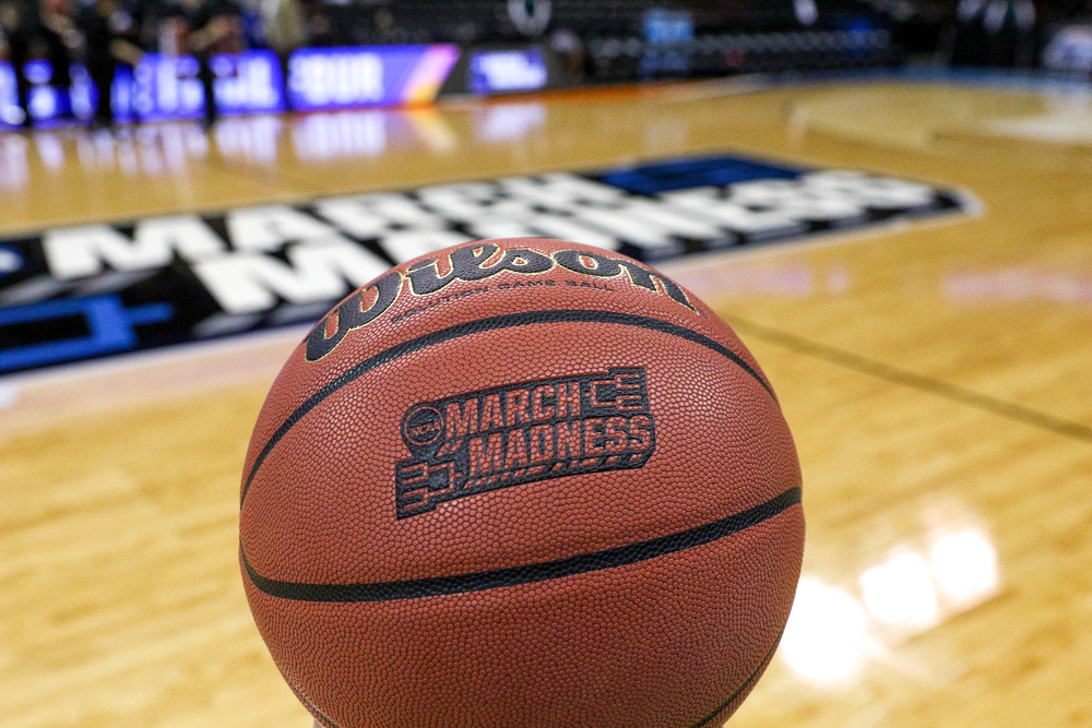 March Madness basketball on a basketball court