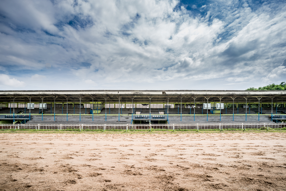 racecourse track with wooden grandstand