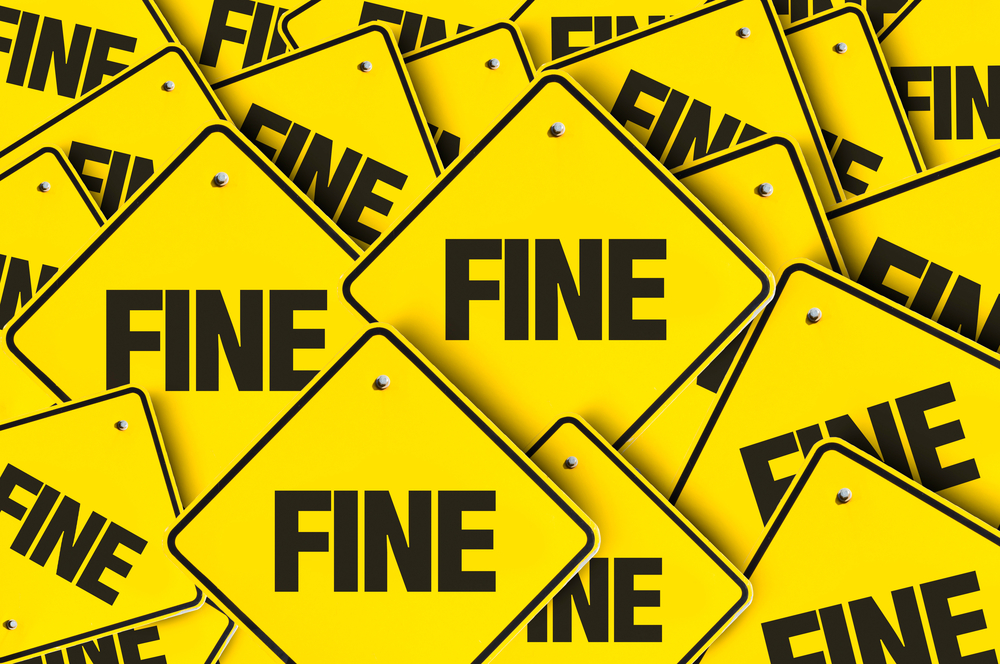 yellow signs reading fine