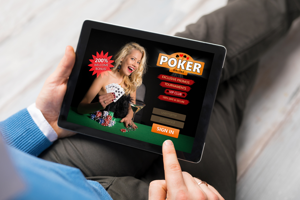 man playing online poker on tablet