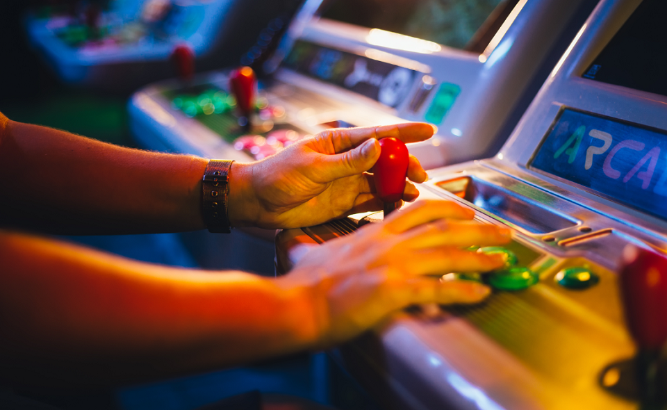 male playing arcade game