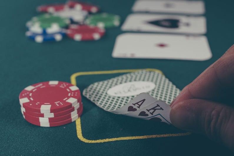 Poker player peeking at A-K during live game