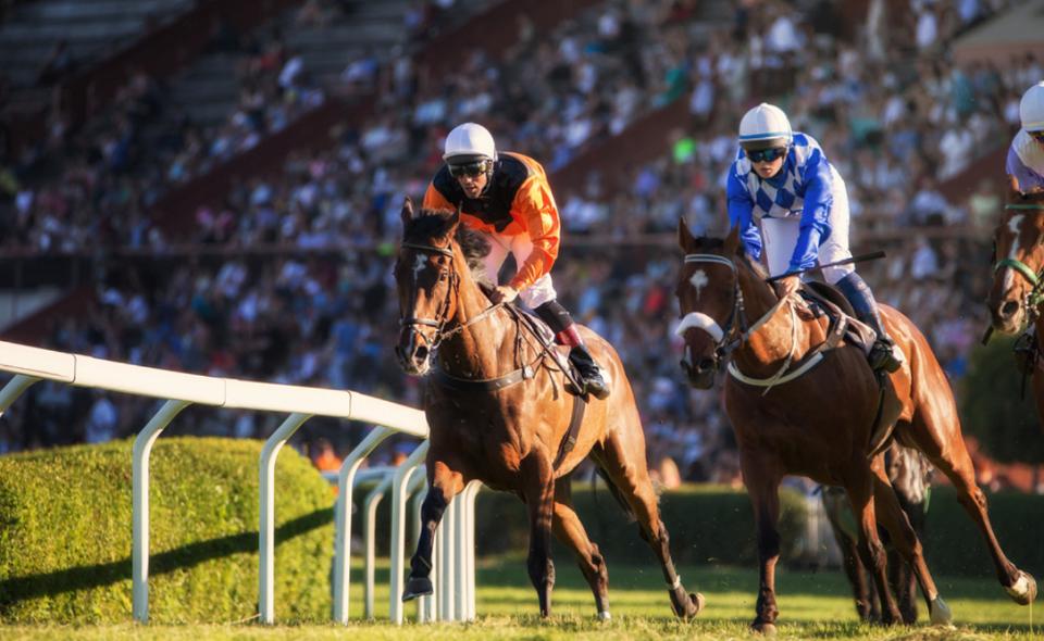 Two jockeys during horse race