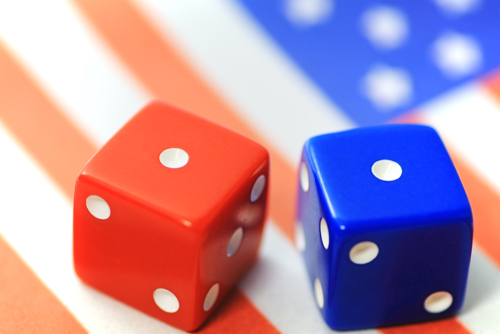 two dice against an American flag background