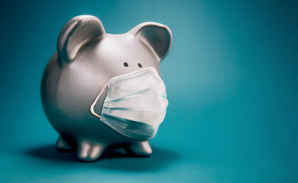 piggy bank wearing protective face mask