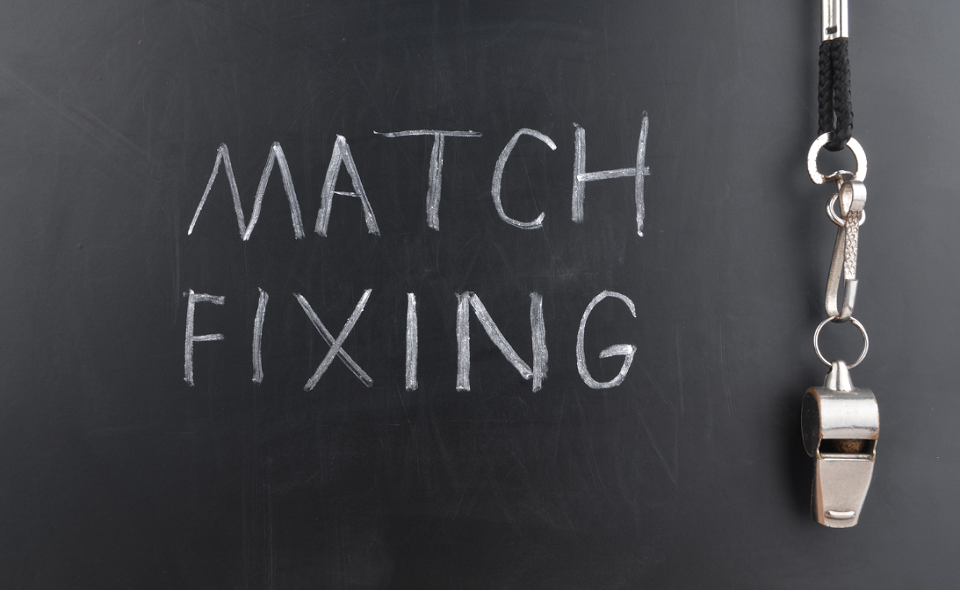 """""""match fixing"""" written on chalkboard with whistle"""