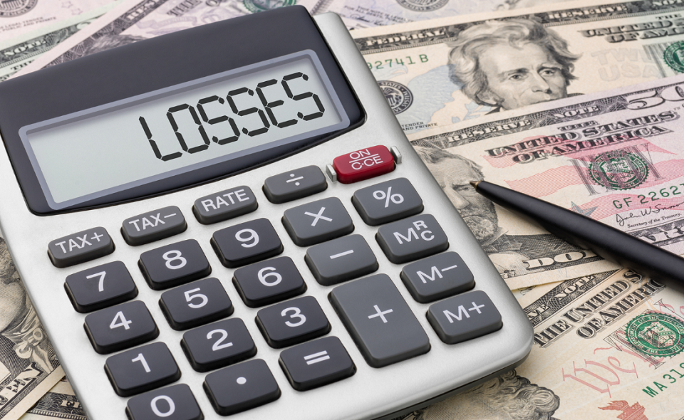 calculator with money - losses written on screen
