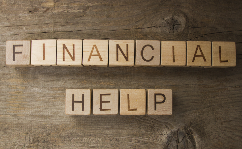 Financial help text on a wooden background
