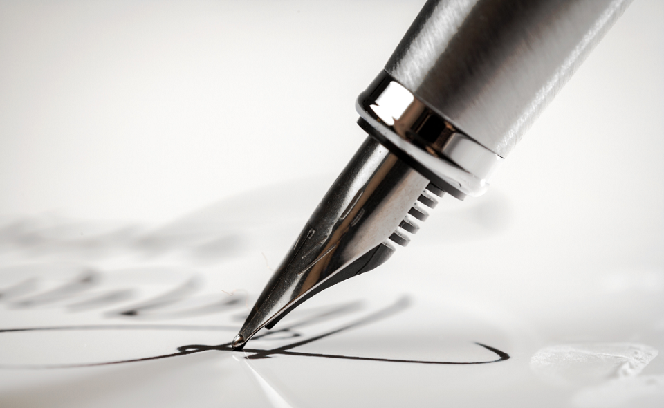 signature being written