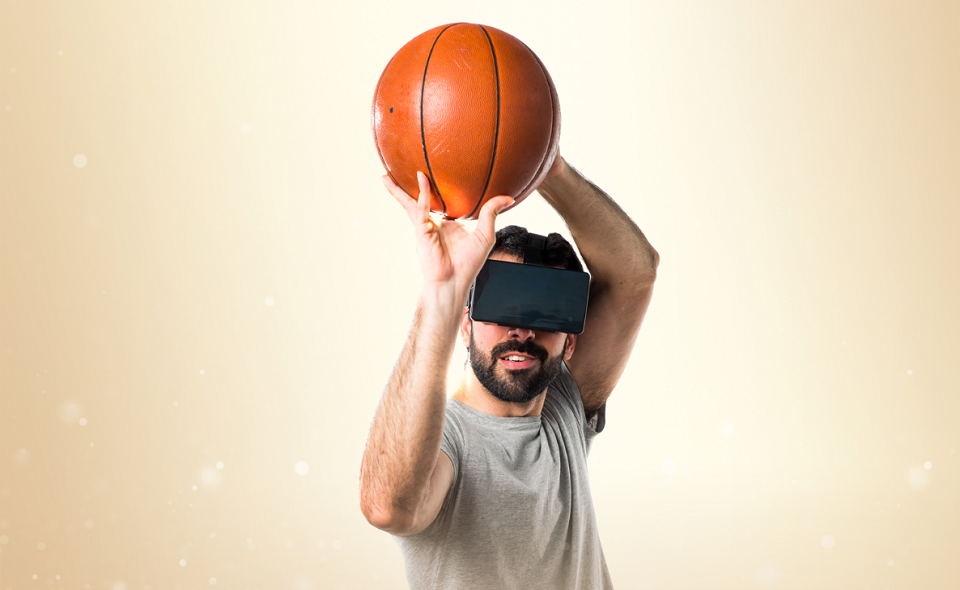 man playing basketball using VR glasses