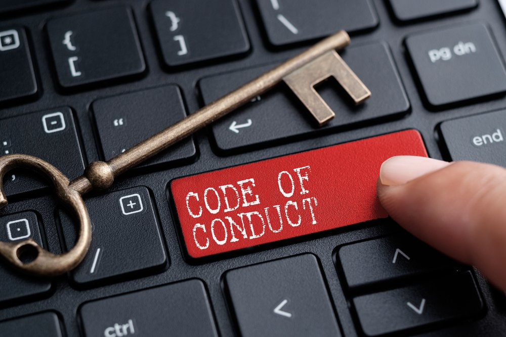 keyboard button with the words code of conducted