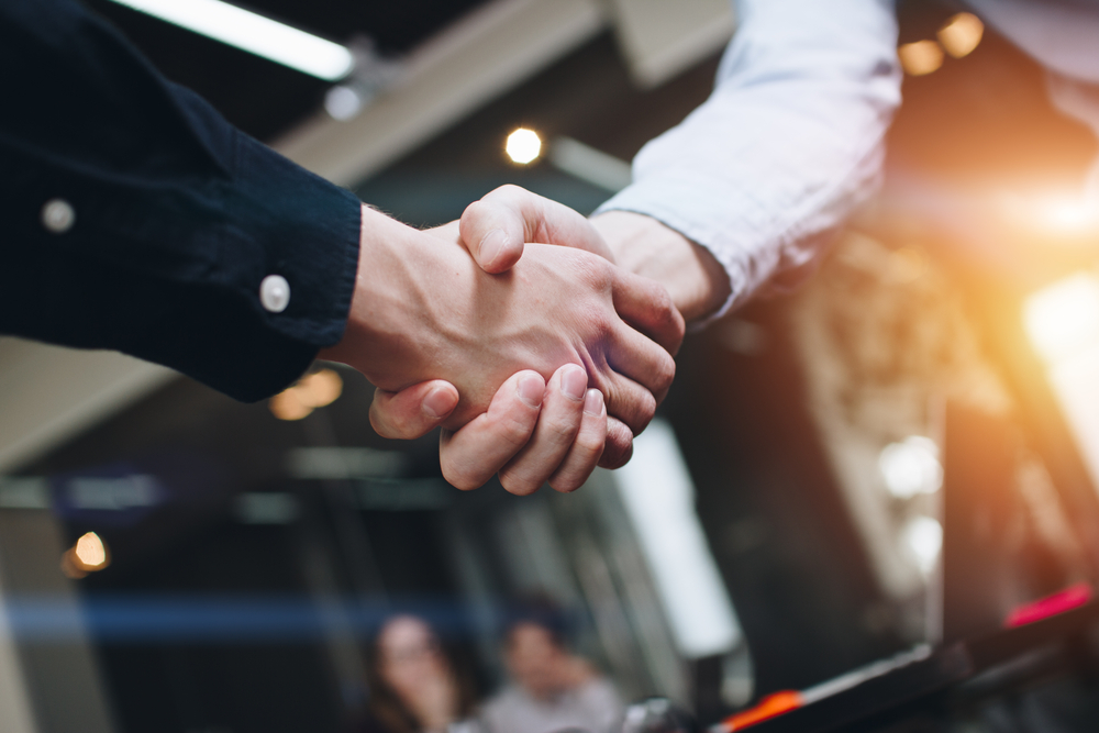 two business people shaking hands symbolizing agreement