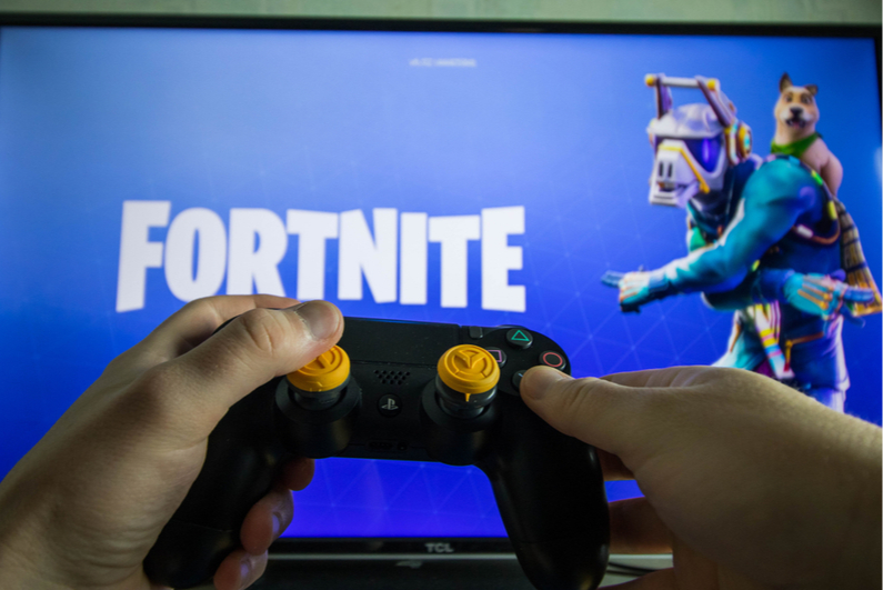 Person playing Fortnite with PS4 controller