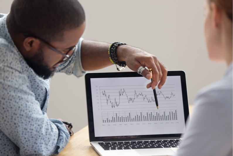 Man explaining line graph on laptop