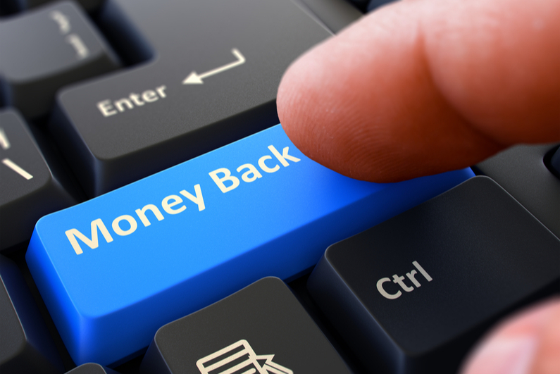 """Person pressing """"Money Back"""" button on keyboard"""