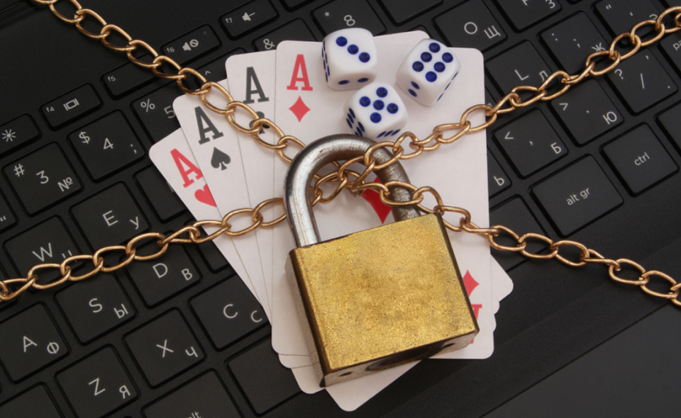 locked dice, playing cards and computer keyboard