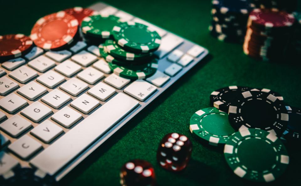 computer keyword and poker chips
