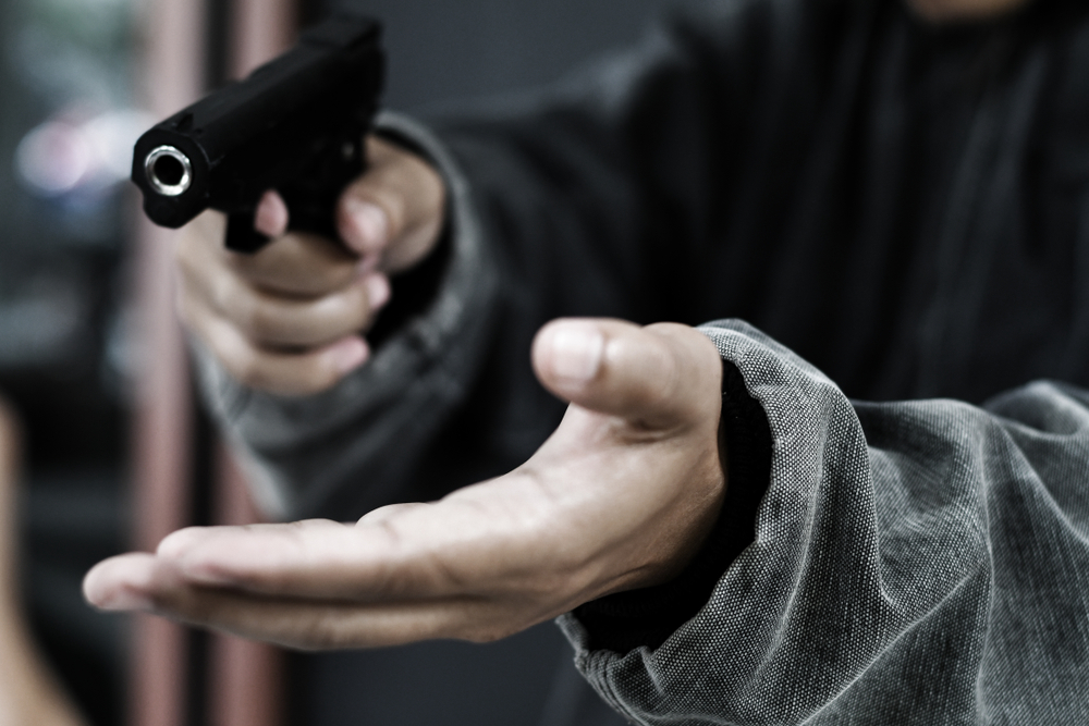 armed robber pointing gun