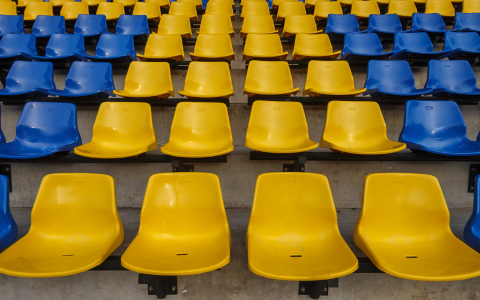 Empty blue and yellow stadium seats