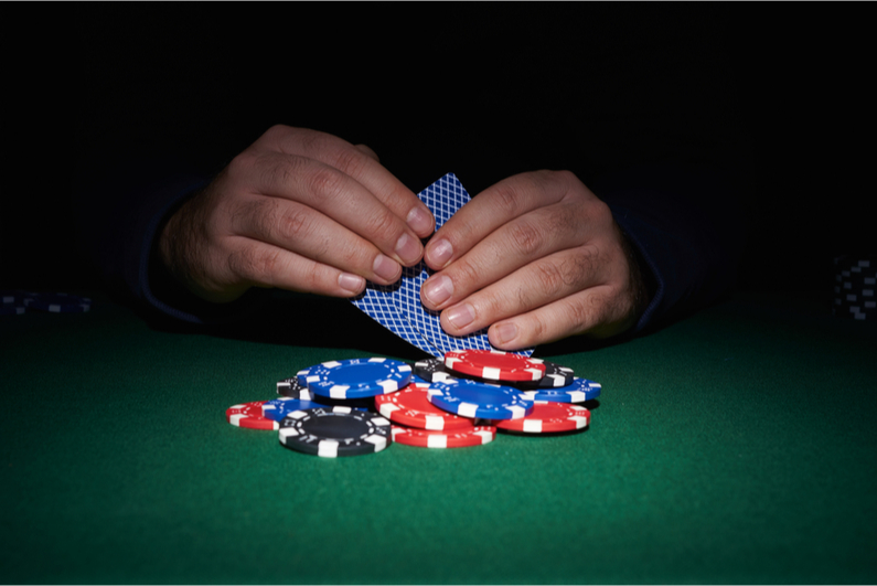 Poker player looking at hole cards