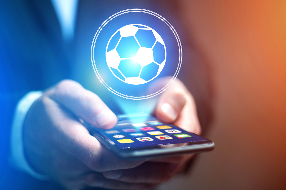 virtual soccer ball projection above smartphone