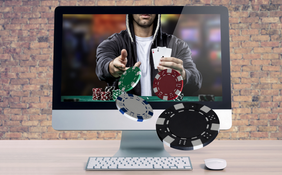 Online poker player with chips coming out of computer monitor