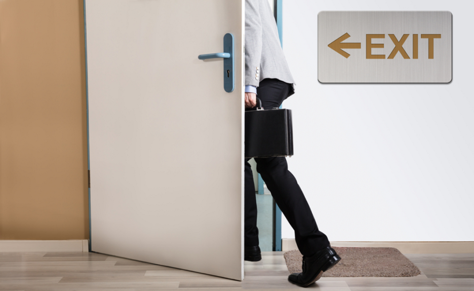 businessman exiting office