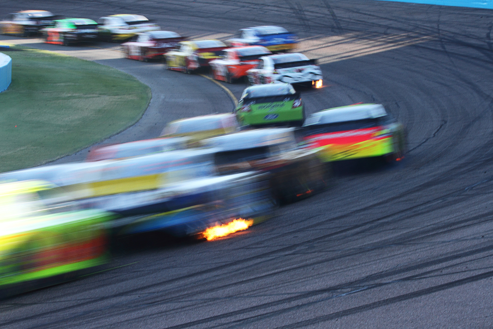 blurred image of racing track filled with cars